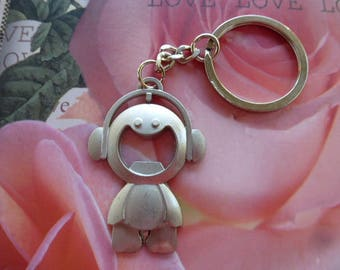 boy with headphones headset in silver metal keychain