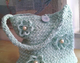 Shoulder bag crocheted in shiny Ribbon adorned with flowers and pearls