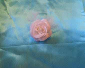 with a white rose hair clip