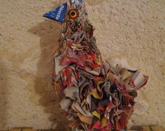 Chick in recycled newsprint
