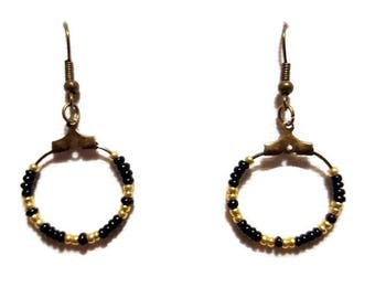 Black and gold seed beads and bronze earrings