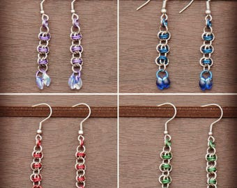 Rhyno dangle earrings in stainless steel and anodize aluminum.