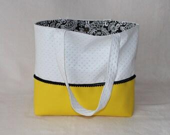 Yellow and white handbag