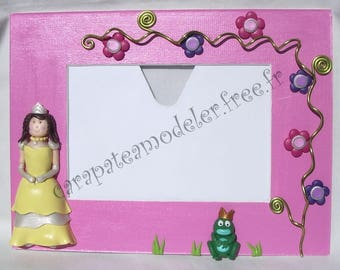 In her yellow dress and frog Princess photo frame