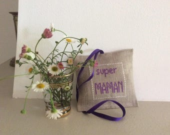 Small pillow trimmed in lavender with cross stitch Embroidery