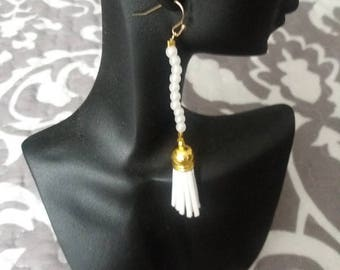 Earrings with bead and tassel