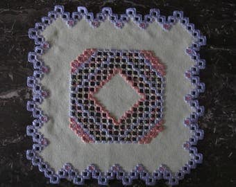 Purple and green Hardanger embroidery doily