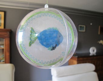 Transparent ball containing two fish embroidery