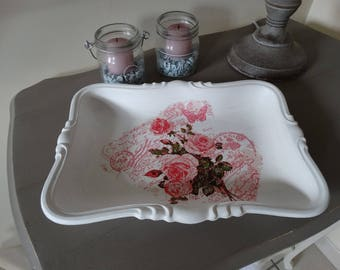 White color and floral metal tray.