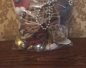 Bag of Christmas items--ornaments, trim, etc.