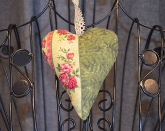 heart hanging in pink fabric