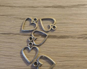 set of five heart shaped pendants