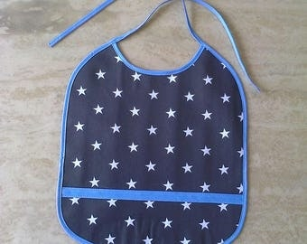 printed in black oilcloth bib star white and blue trim