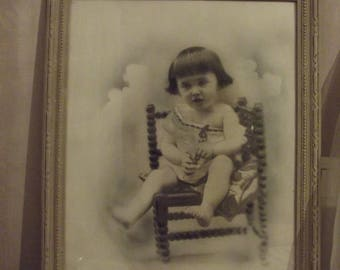 PHOTO SEPIA PHOTO OF A YOUNG CHILD IN ITS ORIGINAL FRAME REWORKED