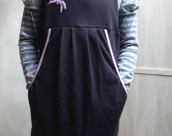 Black with large pocket, black and pink tunic