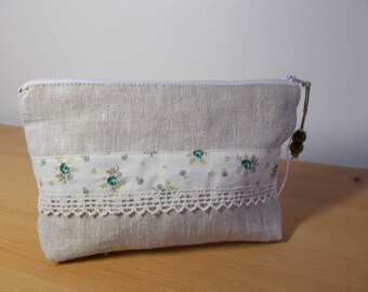 Linen and cotton flowers with antique lace clutch