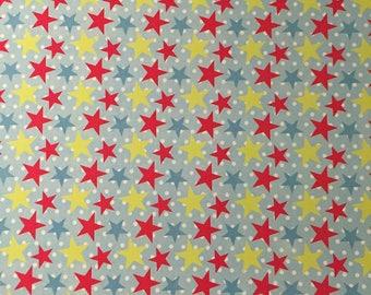 Feuille A4 Papier léger glacé à motif coloré - Etoiles multicolore façon cirque