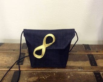 POUCH MADE OF SINAMAY NAVY BLUE AND HER BUG INFINITY YELLOW