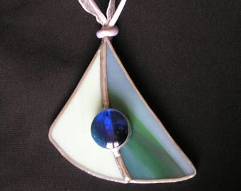 Green and Blue Pearl with its glass pendant necklace attached