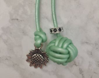 Monkey fist knot bookmark with a antique silver sunflower