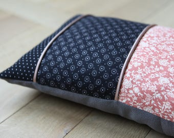 Cushion in shades of pink and black