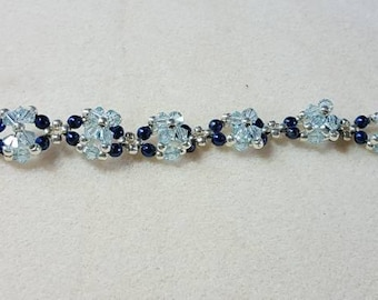 Swarovski crystal and blue pearl beaded bracelet.  Toggle clasp