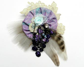 Fancy blue and purple colors with feathers brooch