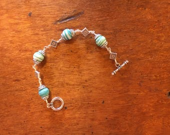 Wire wrapped turquoise blue beaded bracelet