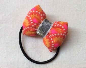 scrunchy with a Petit Pan Wasabi red fabric bow