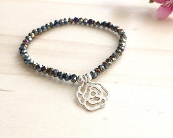 Bracelet has 925 sterling silver rose beads