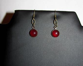 Small earrings for genuine carnelian on metal color bronze