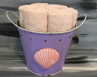 Purple Distressed Bathroom Bin - Bathroom Wash Cloth Holder with Seashell with 7 light peach wash cloths.
