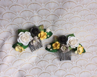 Pair of yellow, gray, and white flower hair combs