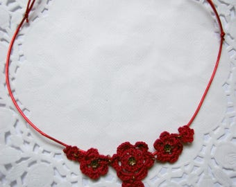crochet necklace with red cherry blossoms on a red cord