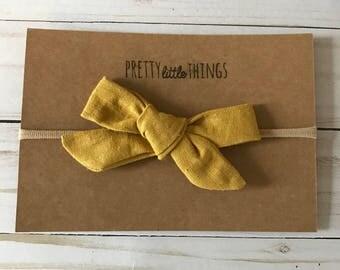 Mustard classic tied bow on nylon headband