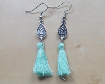 Earring with turquoise tassel