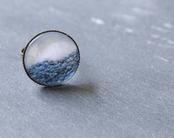 "Ring bronze plated brass topped with a ""Pebble Beach"" cabochon glass"