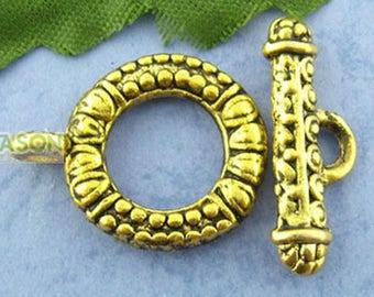 FR35 - Lot 4 o23mm antique gold toggle clasps