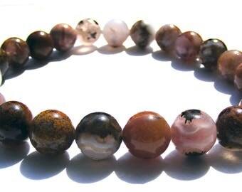 Bracelet jaspe composé de 24 perles de 8 mm rose, multicolore et ficelle élactic.