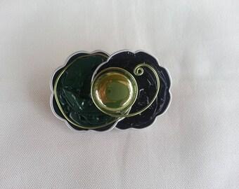 Brooch in green nespresso capsules