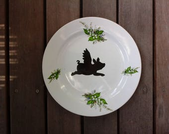 Vintage plate with flying pig and flower