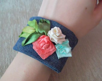 Bracelet on the hand decorated with flowers - The combination of romantic and sport - from ribbons and cloth, jeans, floral
