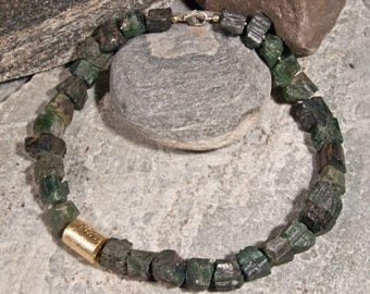 Necklace of raw, dark green tourmaline nuggets with elements of gilded 925 silver