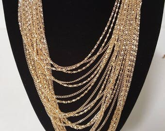 Gorgeous gold multi-strain necklace and earring set