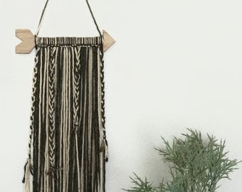 Arrow yarn wall hanging with feathers