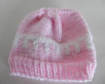 Knitted dark pink baby hat