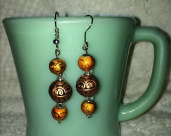 copper and orange earring