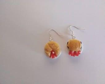 Pair of greedy earrings