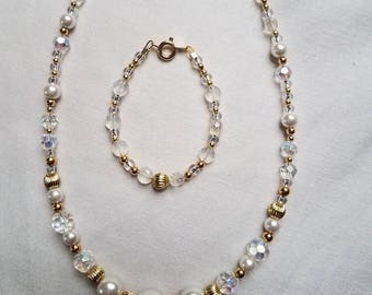 Beautiful crystal and gold add a bead set