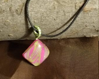 Pink and green swirled resin pendant